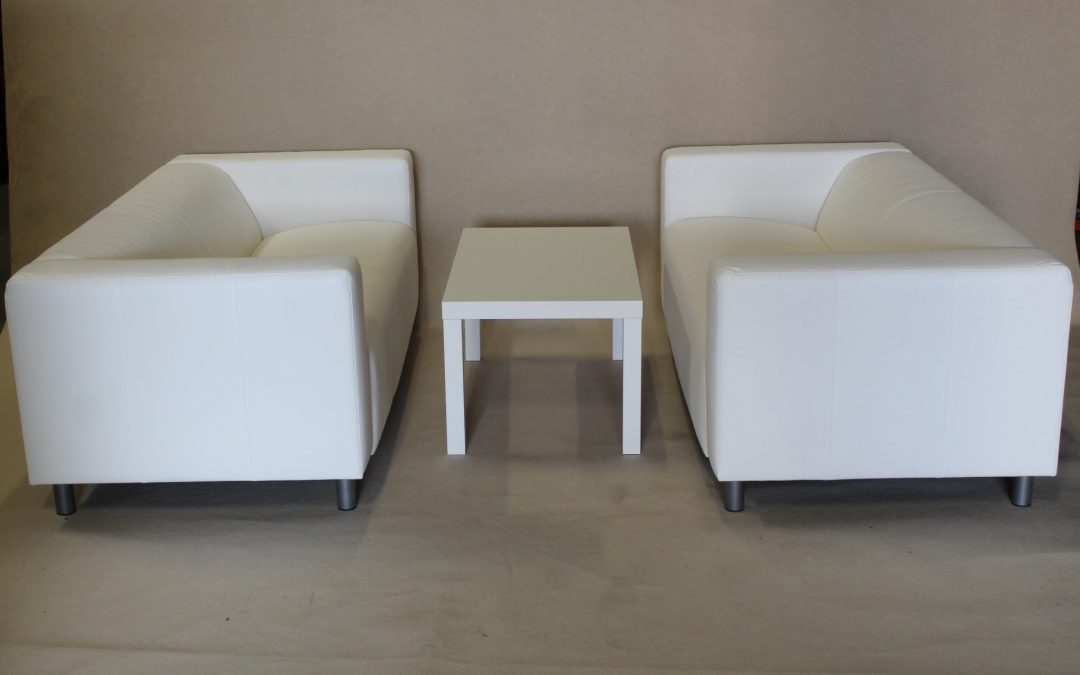 White sofa with coffee table